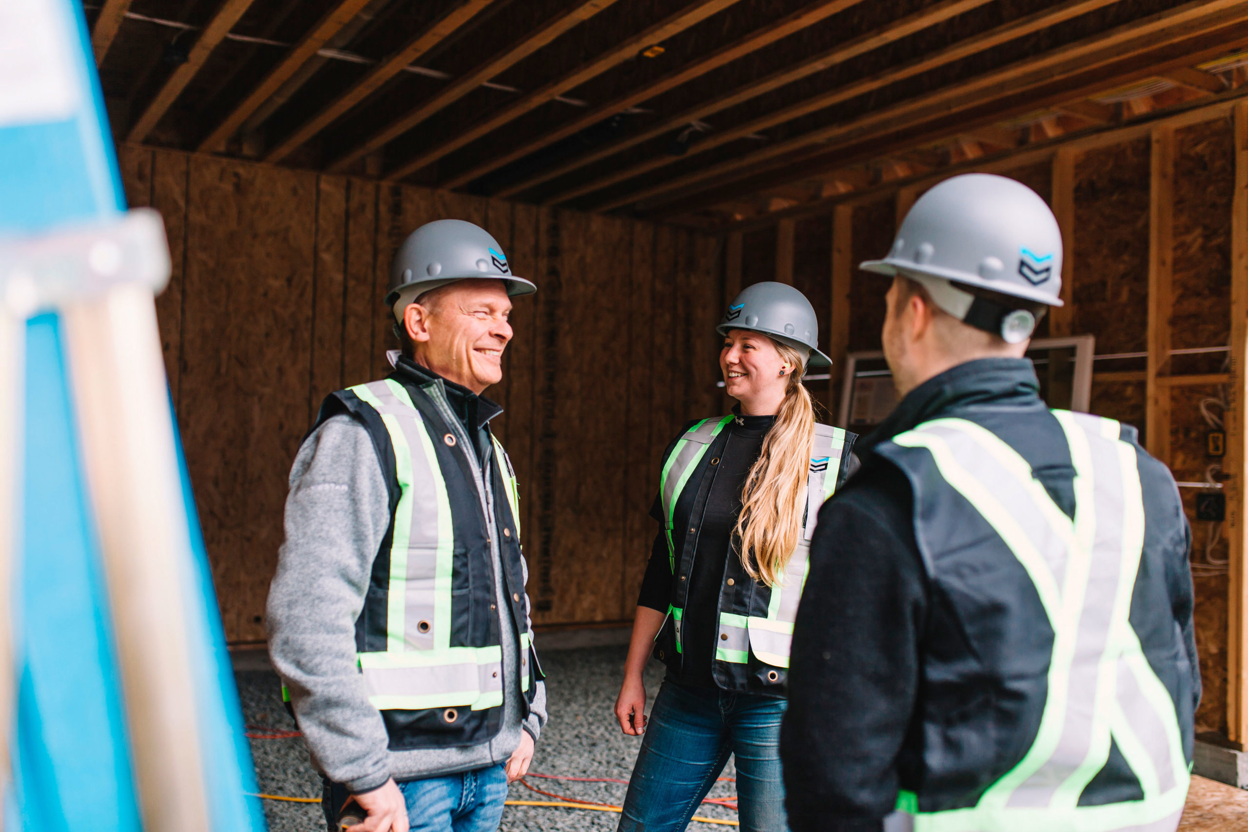 Team discussing a plan on a construction site